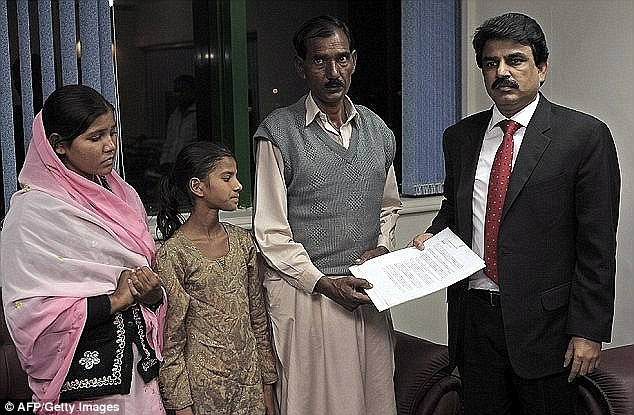 Death sentence: Ashiq with Sidra, second left, and Esham, left, with Pakistani minister of minority affairs Shahbaz Bhatti, right. He was later murdered for speaking out against the country's blasphemy law