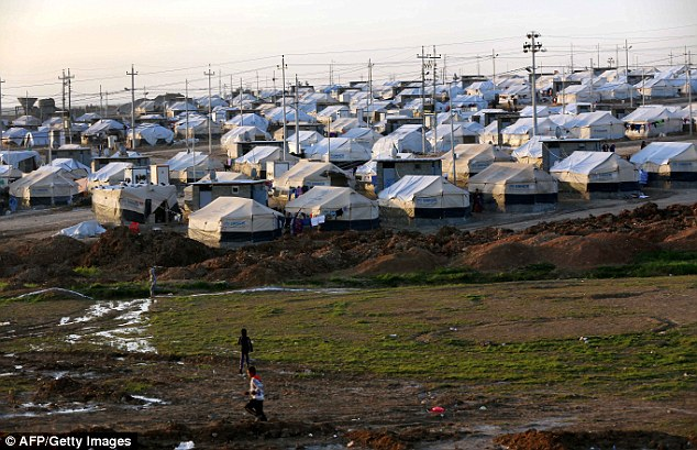 Overflowing: The Khanke refugee camp (pictured) where Reehan and Barfo now live is also  home to tens of thousands of Yazidis and other refugees who have been forced to abandon their homes in Iraq