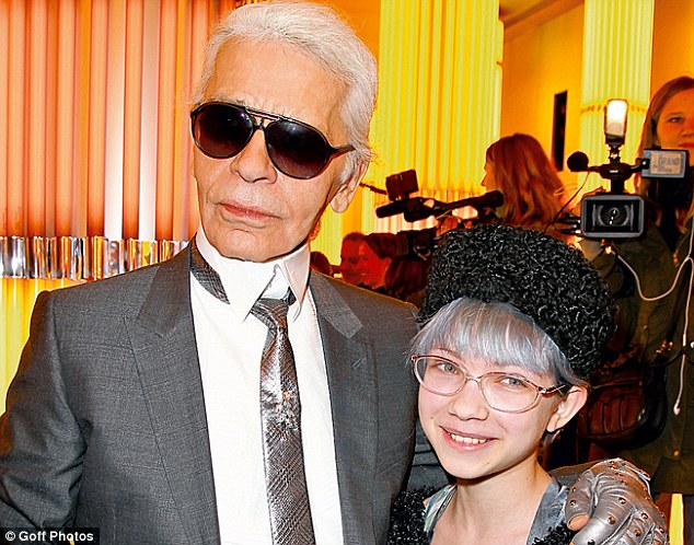Tavi, pictured with Karl Lagerfeld in 2010, sports the grey haired 'granny look' before it became popular