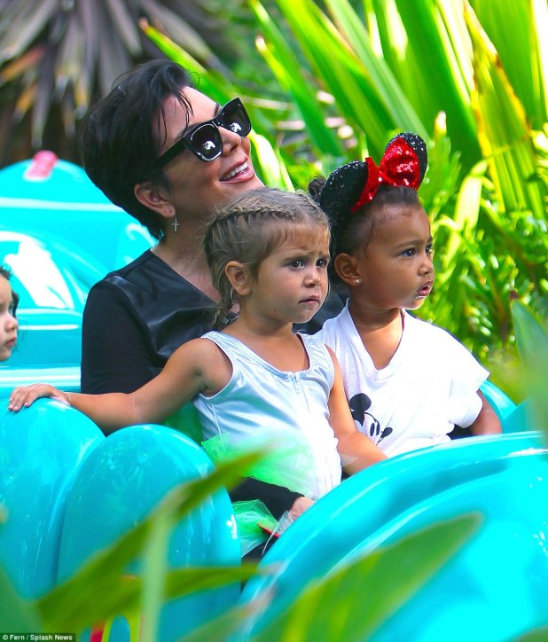 Sweet: BFFs Penelope and North enjoyed the caterpillar ride with their doting grandmother Kris