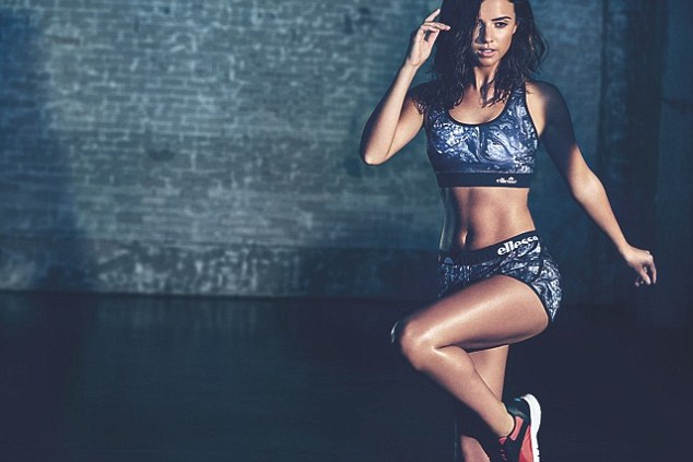 Lucy Mecklenburgh showcases her ripped abs and super-toned legs as she model the new spring/summer 2015 gym wear line for Ellesse
