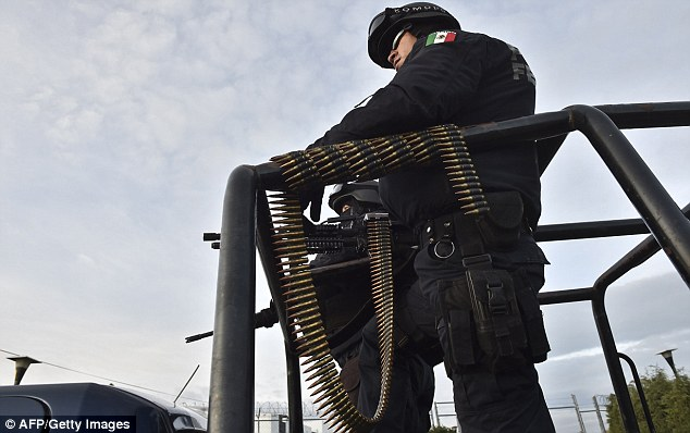 Armed: Policemen outside the jail in central Mexico on Sunday. A huge manhunt is under way