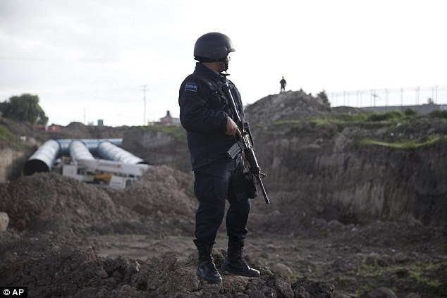 Federal police officers stand guard outside the prison. The huge construction site next to it can be seen