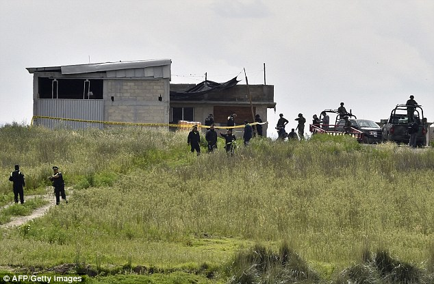 Federal police check a house at the end of the tunnel through which he could have escaped