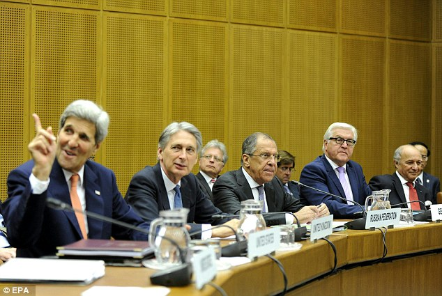 U.S. Secretary of State John Kerry, British Foreign Secretary Philip Hammond, Russian Foreign Minister Sergei Lavrov, German Foreign Minister Frank-Walter Steinmeier and French Foreign Minister Laurent Fabius take part in a press conference to announce the agreement