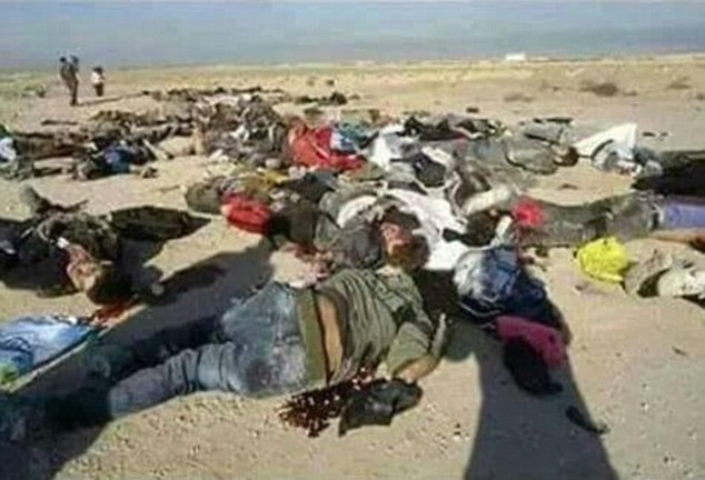 Slaughter: The men were lined up in a ditch and shot in the head by laughing ISIS gunmen. A survivor told how he played dead while covered in victims' blood and hid among the dead bodies