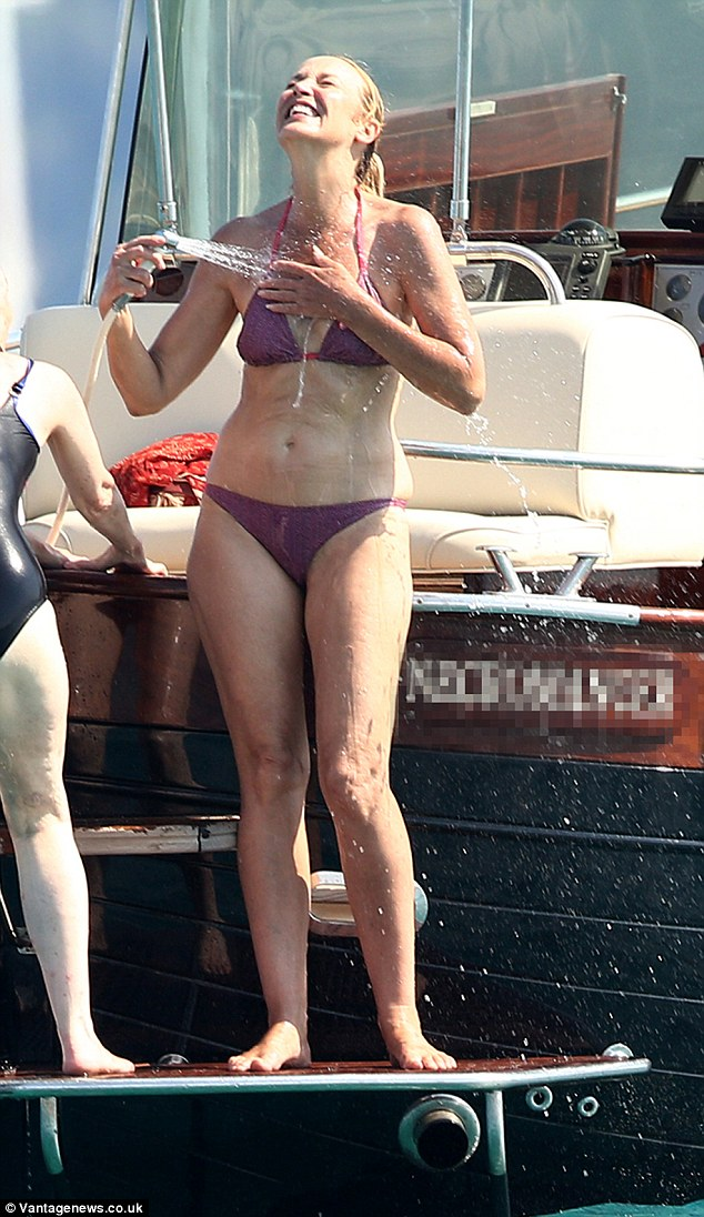 Jerry Hall Displays Her Flat Tummy On A Boat In A Teeny