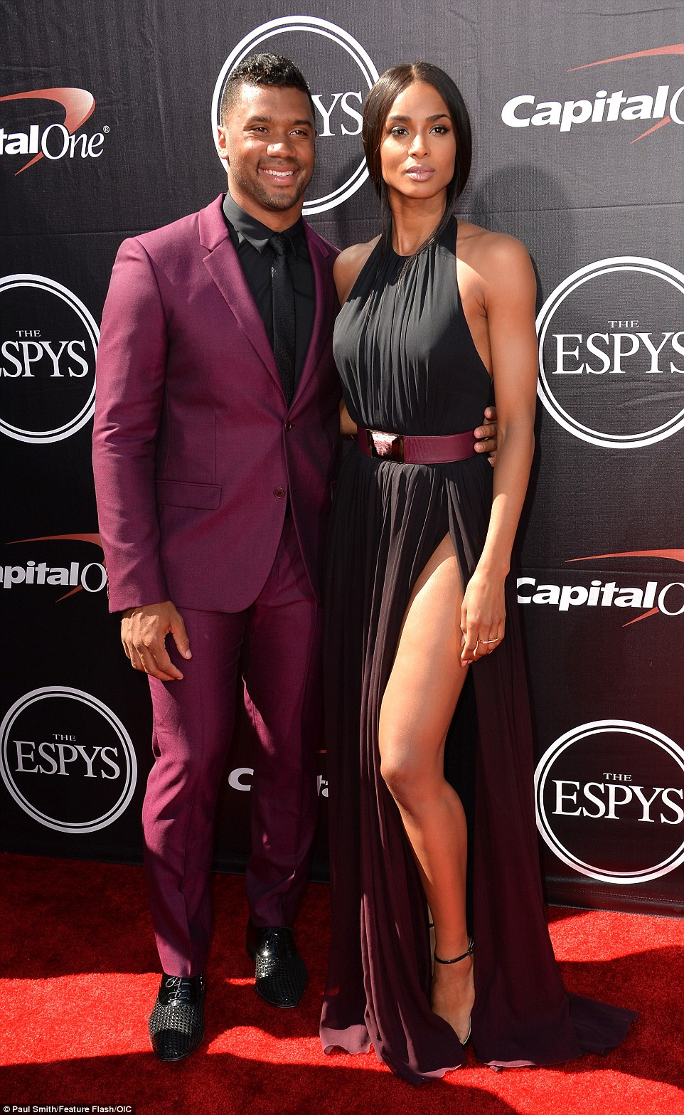 Magnificent in mauve: Ciara wore a stunning floor length gown to the ESPYs on Wednesday and walked the red carpet with her beau Russell Wilson