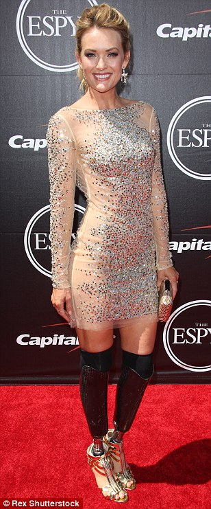 Proud: Amy Purdy wore a stunning sequin shimmering gown, which skimmed her thighs and showed off her prosthetic limbs