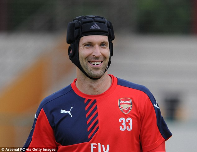 The 33-year-old goalkeeper is all smiles following a busy workout during an Arsenal training session in Asia