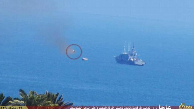Attack: Eyewitnesses said a boat patrolling the Sinai coastline spotted a group of ISIS jihadis on the shore and engaged them. A rocket fired from the shore (circled) struck the vessel moments later