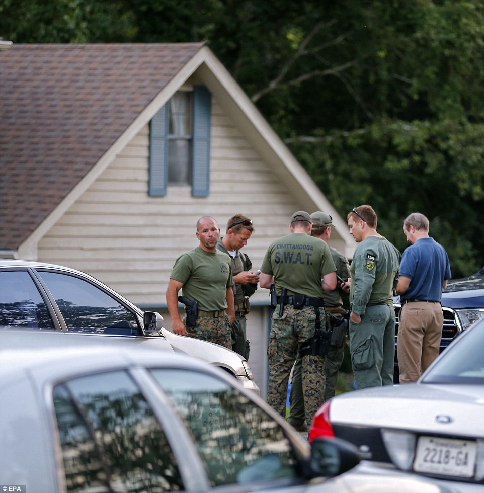 Investigation: Law enforcement personnel gather outside the home of gunman Mohammod Abdulazeez. FBI officials said no one else has been taken into custody and no one else is believed to be involved