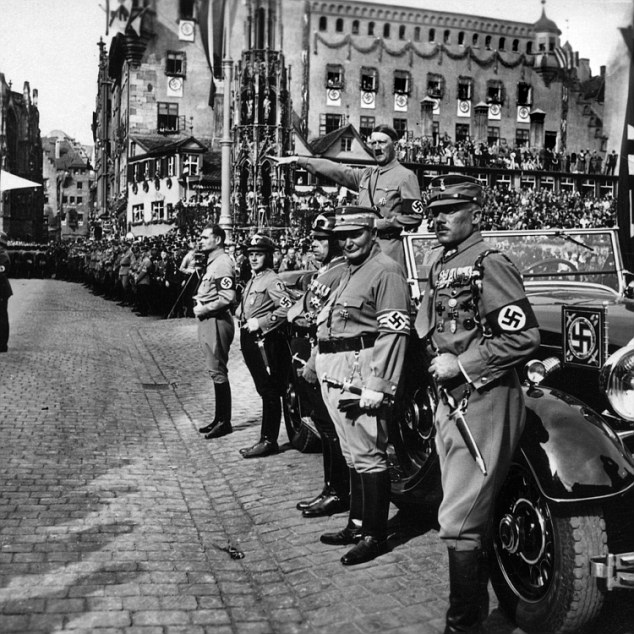 Salute: The Nazi salute became a symbol of fear across Europe after the rise of Hitler. But at the time the footage was taken there was not 'a child in Britain in the 1930s or 40s' who had not 'performed a mock Nazi salute as a bit of a lark', according to historian James Holland