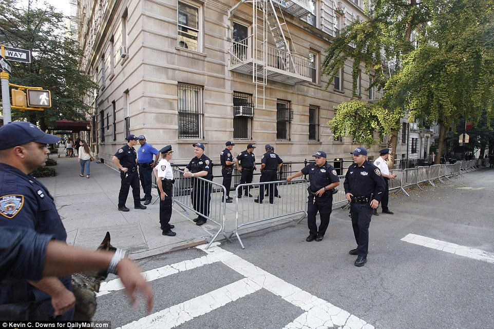 A large police presence was on hand for President Obama while he visited  the posh uptown townhouse