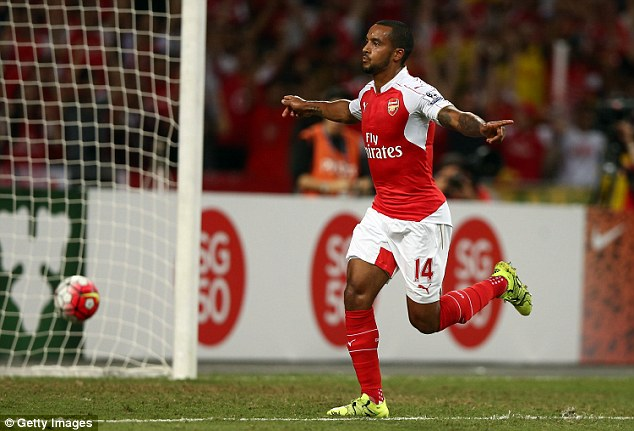 Theo Walcott celebrates after giving Arsenal the lead against Everton in the Barclays Asia Trophy final