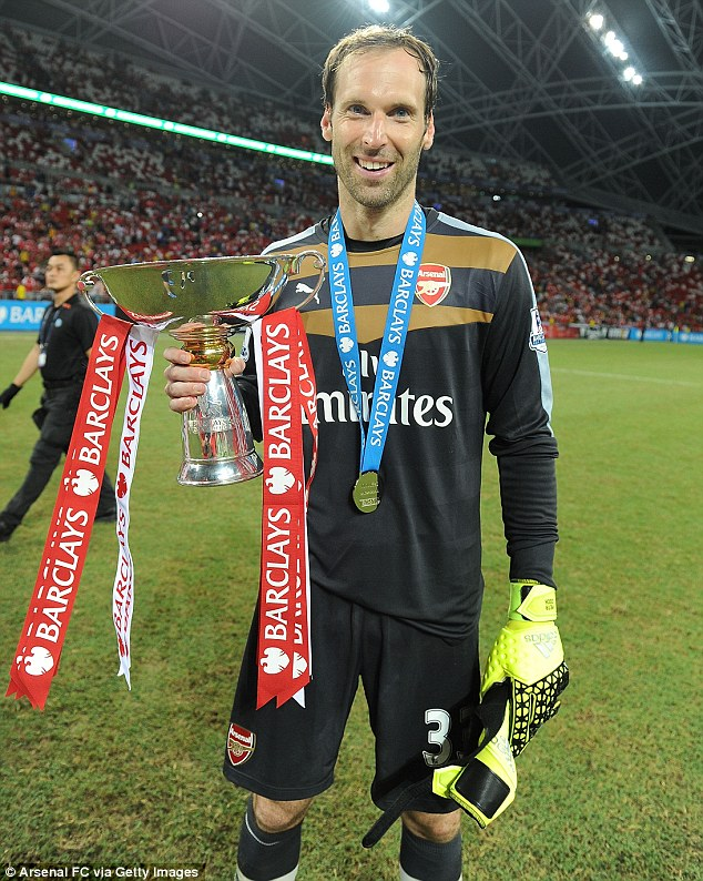 Petr Cech celebrates with the Barclays Asia Trophy following the Gunners' 3-1 win over Everton on Saturday