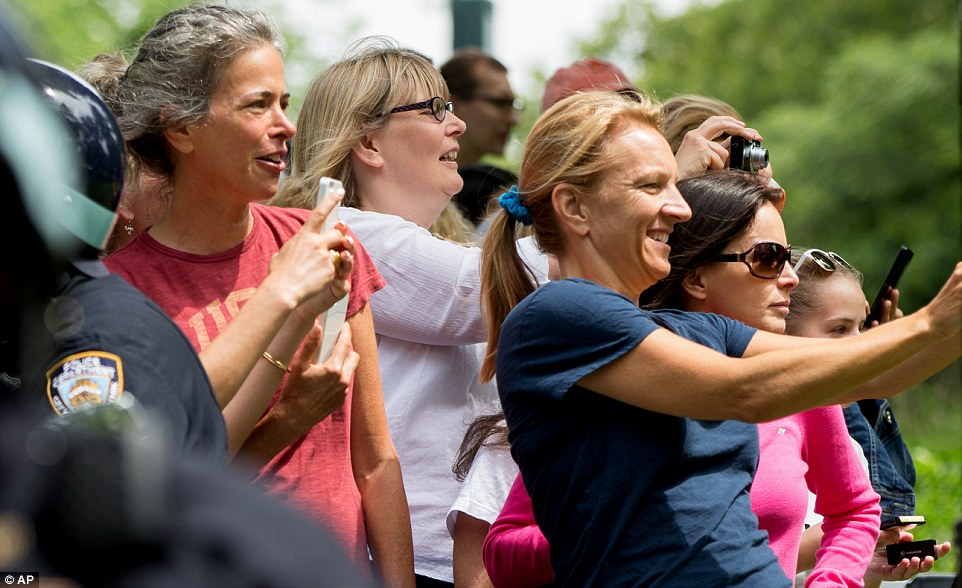 Excited! Central Park visitors lined the paths with their phones desperately trying to catch a snap of the First Family