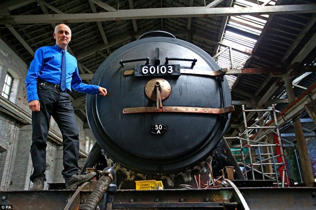 Curator of Collections and Research at the National Railway Museum Bob Gwynne checks on restoration work on the Flying Scotsman