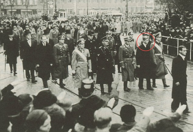 Sombre: Philip, circled, is pictured with relatives wearing Nazi uniforms at his sister Cecile's funeral in Germany in 1937