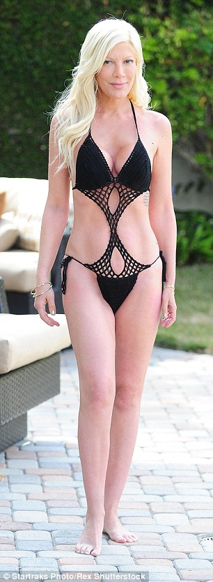 Now and then: Tori Spelling showed off her lean figure in the same bathing suit she wore three years ago when pregnant with son Finn in 2012