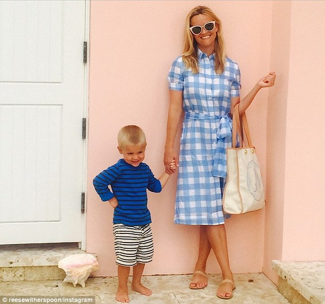 Southern belle: Reese Witherspoon wore a dress from her Draper James collection while posing with son Tennessee in an Instagram post on Monday