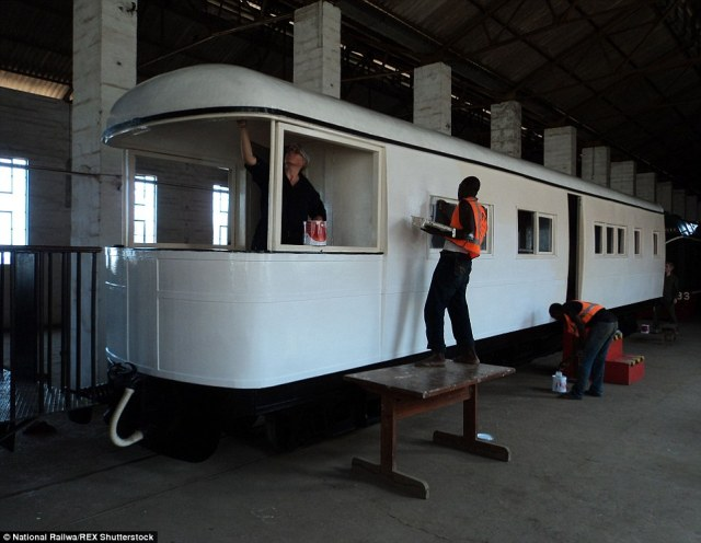 Restored: Museum workers are seen restoring the Royal carriage attached to the Garratt locomotive back in 2011
