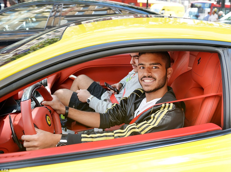 The car's owner, who said he is from Saudi Arabia, was happy to be pictured sitting in the yellow car's red leather interior
