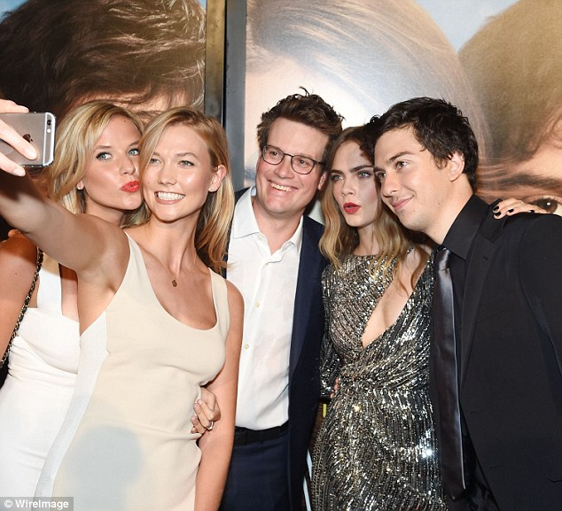 Selfie time! The model held out her phone as she took a photo beside her sister, John Green, Cara Delevingne, and Nat Wolff