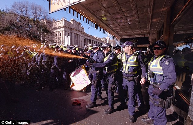 Police blanket protesters in a thick layer of pepper spray which is designed to irritate the eyes by causing inflammation, tears, pain and sometimes temporary blindness