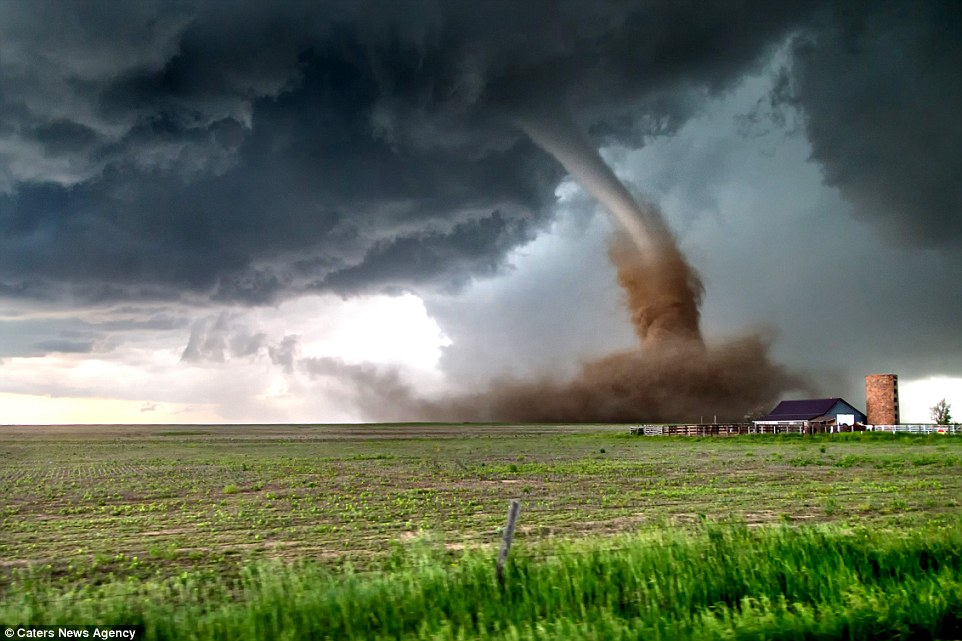 In one photo captured by Brian Morganti a tornado passes perilously close to a farm, with the dark skies clashing with the green grass