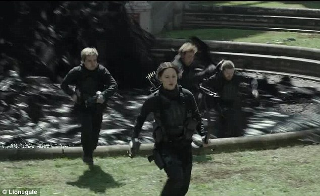 Everyone plays: The exciting trailer shows the rebels taking on what they wryly refer to as the 76th Hunger Games