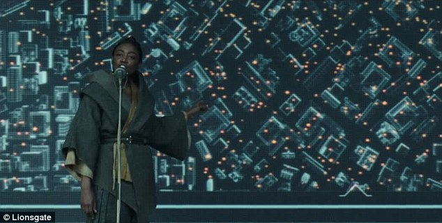 Recon: Commander Paylor, played by Patina Miller, reveals a map of the pod traps littering the Capitol