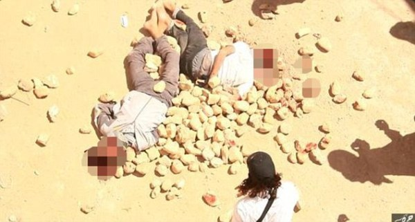 ISIS execute gay men by throwing them from a roof and ...