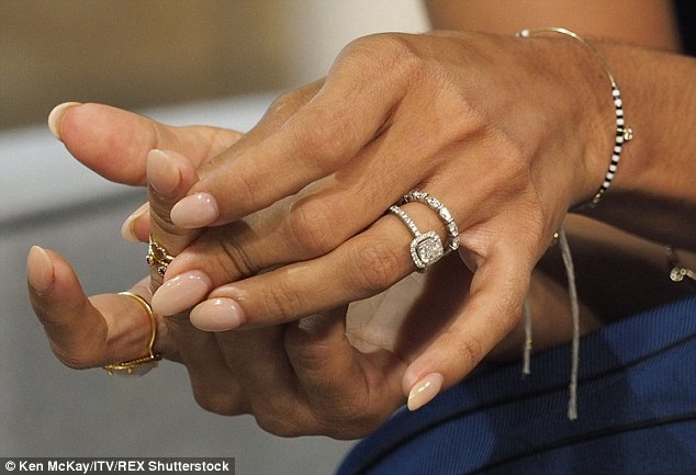 Beautiful: Karen flaunted her gorgeous wedding band as she discussed their special day on the ITV1 show