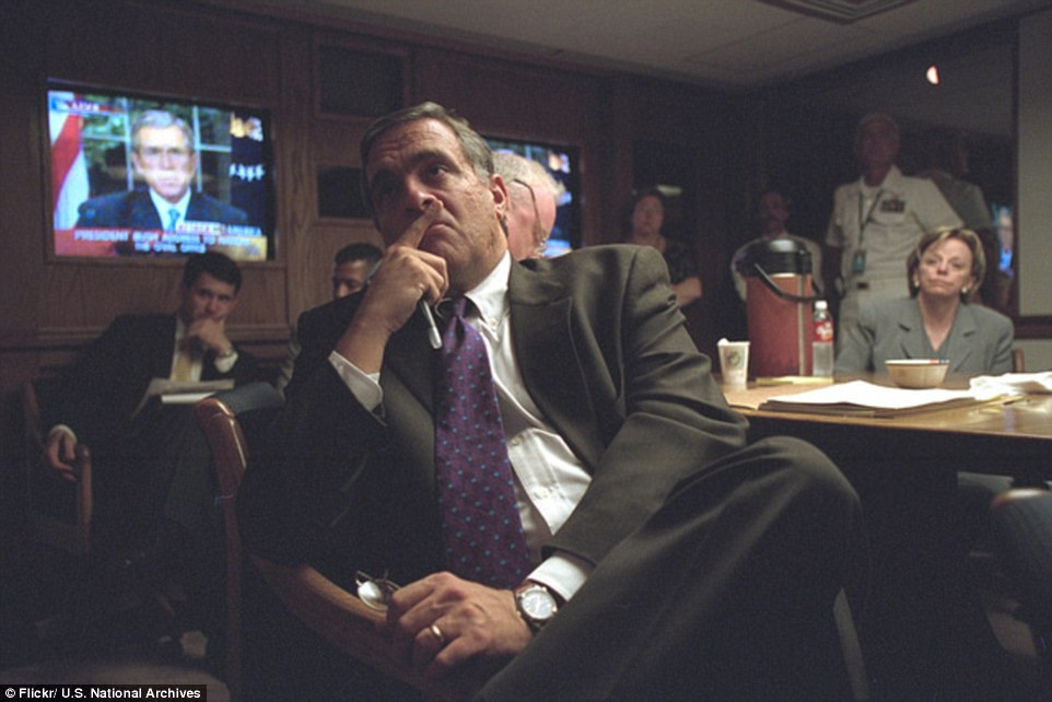 Reassuring the nation: During his address, Bush promised to 'find those responsible and bring them to justice' for committing the 'evil, despicable acts of terror'. Above, Director of Central Intelligence George Tenet is pictured watching the speech at around 8:30pm