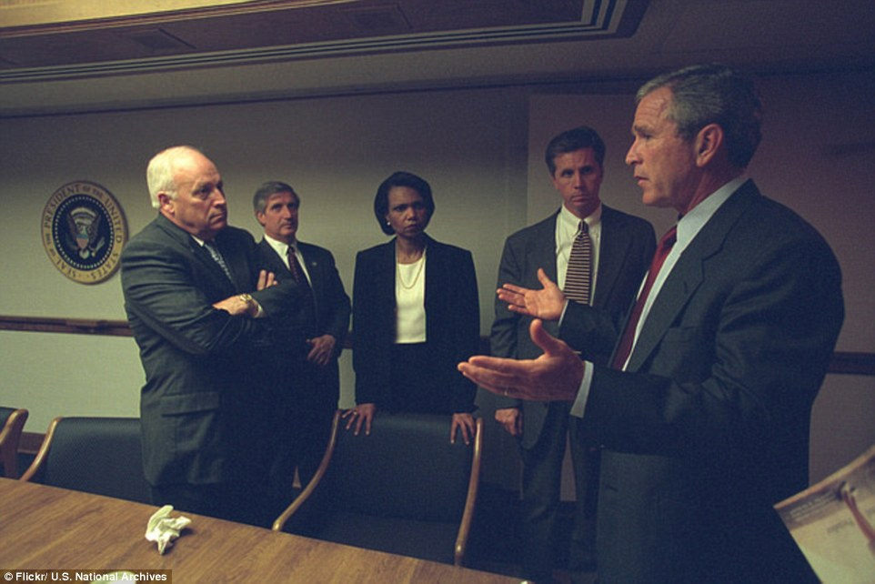 Tense talks: In the images, Bush (far right) looks tense as he confers with Cheney (far left), Chief of Staff Andrew Card (second left), National Security Adviser Condoleezza Rice (center) and other officials in the President's Emergency Operations Center (PEOC)