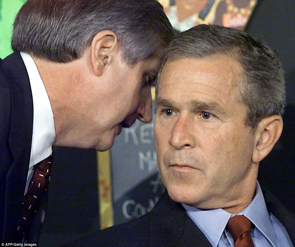 Shocking news: This photo, later seen by people across the world, shows the moment Bush was informed of 9/11 by his Chief of Staff, Andrew Card, who whispered in his ear. At the time, the then-President was attending a school reading event in Sarasota, Florida