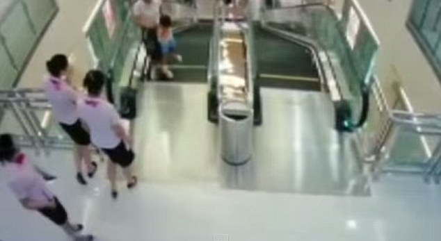 Danger: Mother Xiang Liujuan, 30, was killed when she fell into an escalator at the Anliang department store in Jingzhou. Maintenance workers are being blamed for failing to screw a floor plate back into place (file photo, not the department store)