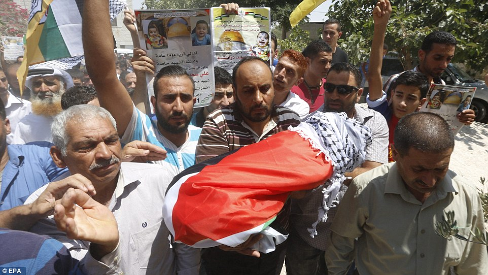 Palestinians carry the body of 18-month-old Ali Dawabsha during his funeral in the West Bank after he was killed in an arson attack by suspected Jewish extremists