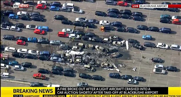 The rows of parked cars at British Car Auctions near Blackbushe Airport that were destroyed by a plane
