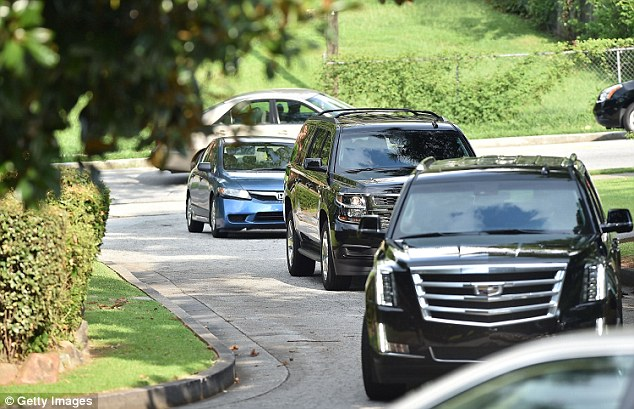 Patrol: SUVs were seen arriving to the Georgia funeral home for the event on Friday