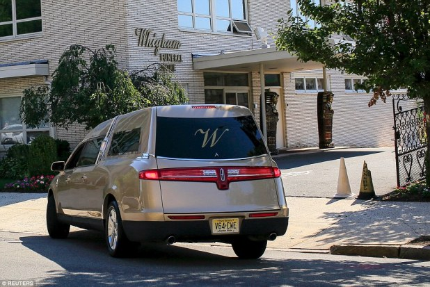 Eternity with her mom: The gold hearse arrives to Whigham funeral home. Bobbi Kristina will reportedly be buried beside her mother at Fairview Cemetery in Westfield