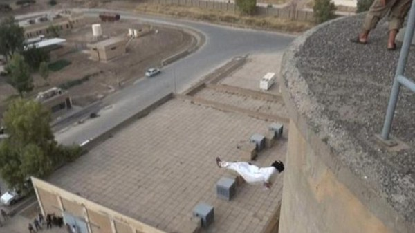ISIS fighters throw man from a building in Iraq for being ...