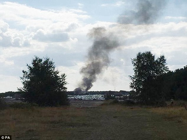 Smoke rising from Blackbushe Airport last Friday after the light aircraft crashed into a car auction