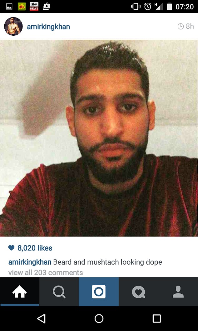 A glum-looking Amir Khan will not be fighting Mayweather next month and he posted this picture