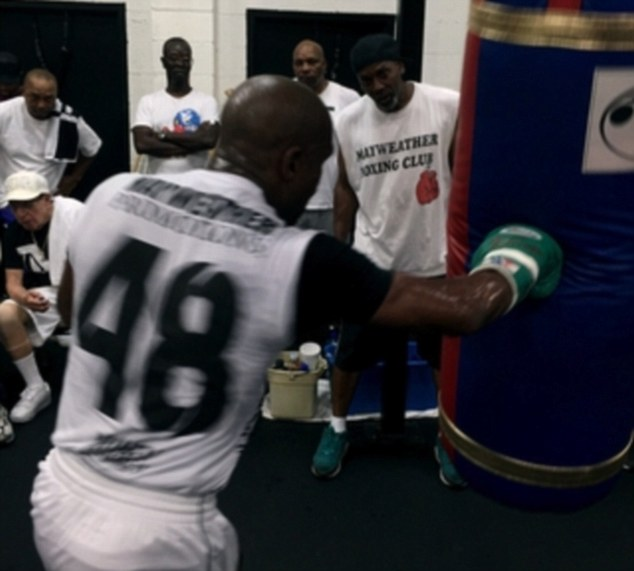 Mayweather uploaded pictures of his training after giving the heavy bag a going over