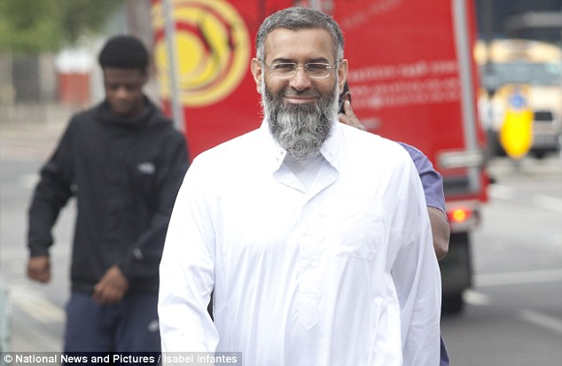 Muslim preacher Anjem Choudary, pictured arriving at Southwark police station today to answer bail, has been charged under the Terrorism Act for 'inviting support for ISIS', Scotland Yard has said