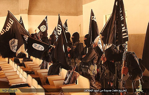 Bleek future: With their black flags and military gear, the new ISIS recruits graduate in Deir ezzor