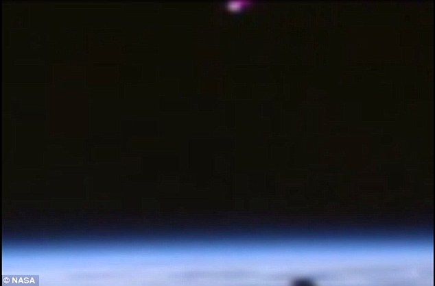 The orb can be seen floating into view. YouTube user Streetcap1 admitted to altering colours on the video