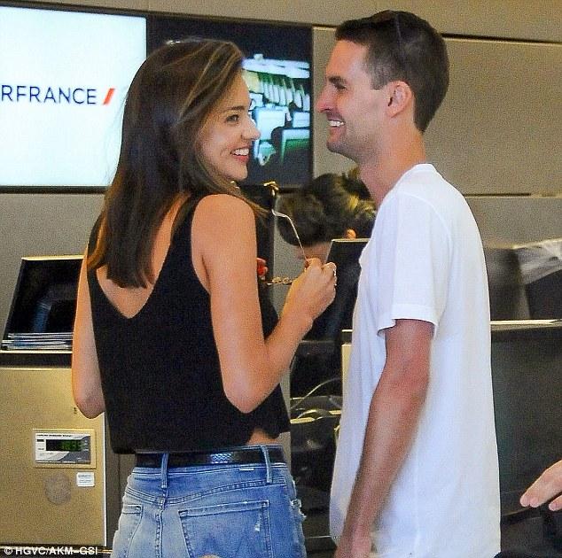 Miranda Kerr Wraps Her Arms Around Billionaire Boyfriend